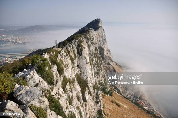 scenic view of sea by mountain against sky in gibraltar - ジブラルタルの岩山 ストックフォトと画像