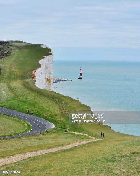 scenic view of sea by mountain against sky - eastbourne stock pictures, royalty-free photos & images