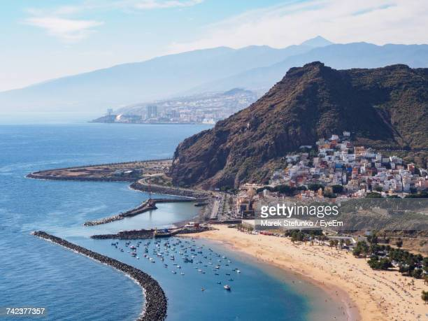 scenic view of sea by mountains against sky - marek stefunko stockfoto's en -beelden