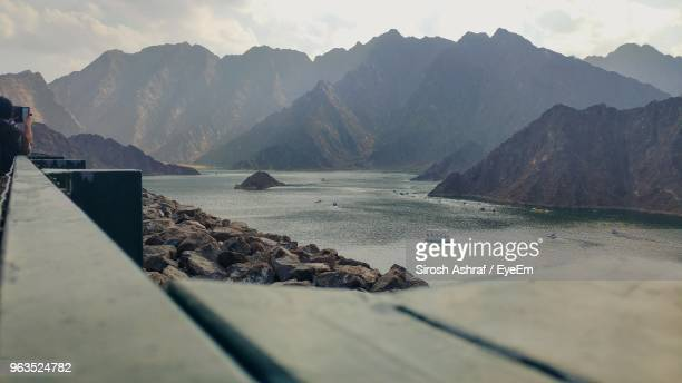 scenic view of sea by mountains against sky - valley stock pictures, royalty-free photos & images