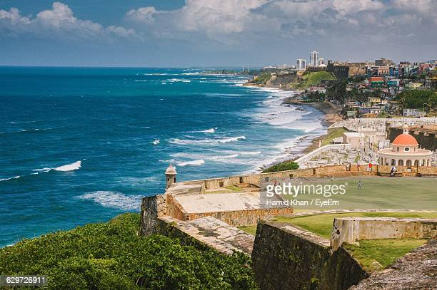 scenic view of sea by puerto rico against sky - puerto rico stock pictures, royalty-free photos & images