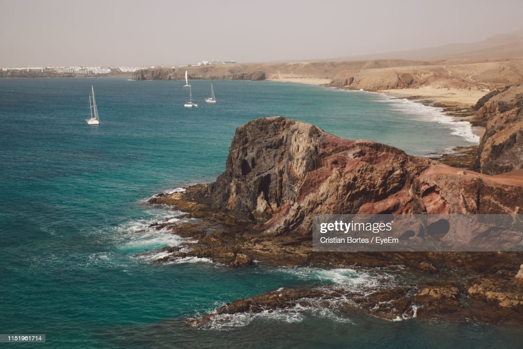 Scenic View Of Sea By Rock Formation Against Sky : Stock Photo