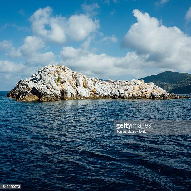 Scenic View Of Sea By Rock Formations Against Sky