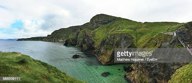 Scenic View Of Sea By Rocky Cliffs Against Sky
