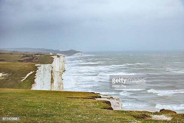 Scenic view of sea by Seven Sisters against sky