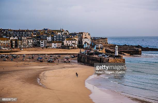 scenic view of sea by town against sky - penzance stock pictures, royalty-free photos & images