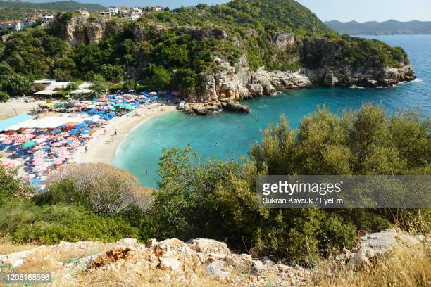 scenic view of sea by trees - kas stock pictures, royalty-free photos & images
