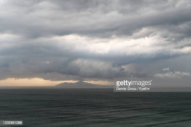scenic view of sea cham islands against cloudy sky - storm dennis stock pictures, royalty-free photos & images