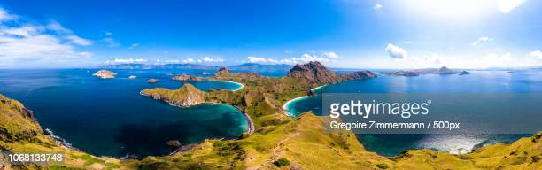 scenic view of sea coast, padar island, indonesia - east nusa tenggara stock pictures, royalty-free photos & images