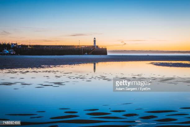 scenic view of sea during sunset against sky - penzance stock pictures, royalty-free photos & images