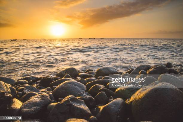 scenic view of sea during sunset - andreas solar stock pictures, royalty-free photos & images
