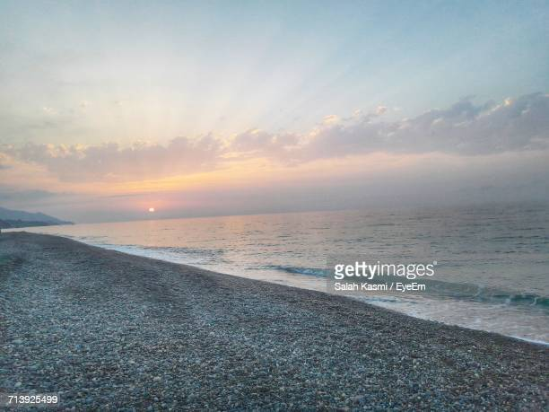 scenic view of sea during sunset - salah stock photos and pictures