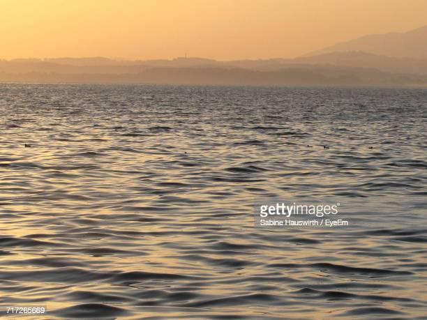 scenic view of sea during sunset - sabine hauswirth stock pictures, royalty-free photos & images