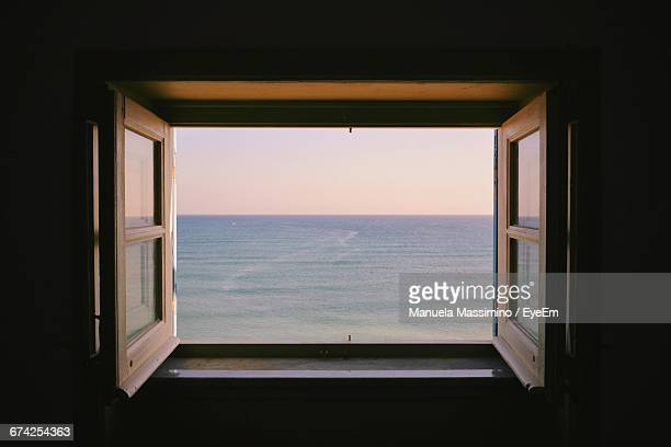 Scenic View Of Sea During Sunset Seen From Window