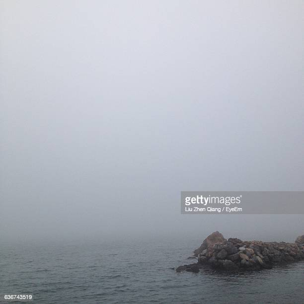 scenic view of sea in foggy weather - liu he stock pictures, royalty-free photos & images
