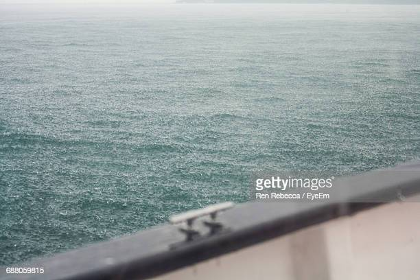 scenic view of sea seen from boat during monsoon - railing stock photos and pictures
