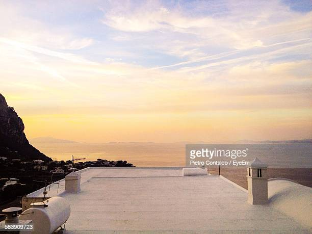 Scenic View Of Sea Seen From Building Terrace At Sunset