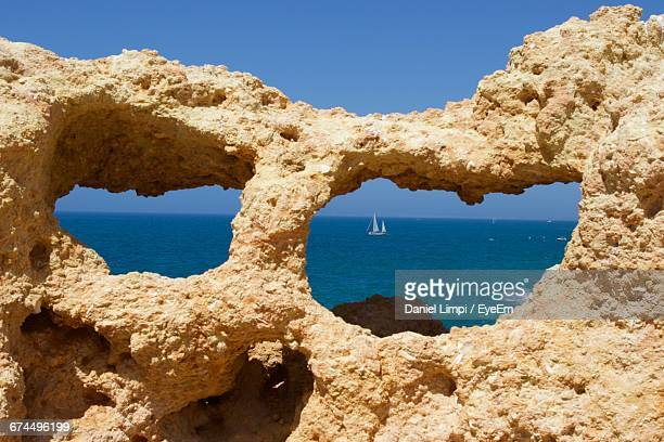 Scenic View Of Sea Seen Through Rock Holes On Sunny Day