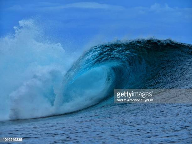 Scenic View Of Sea Waves Against Blue Sky
