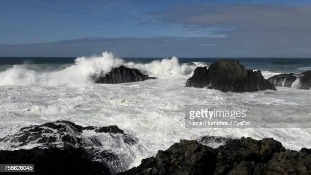 Scenic View Of Sea Waves Against Sky