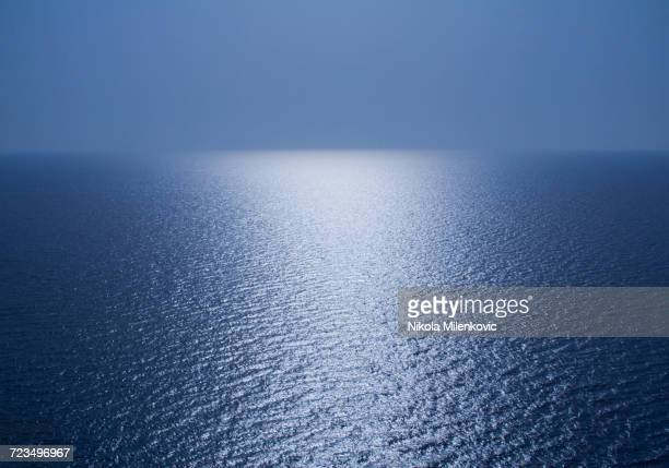 Scenic view of seascape against blue sky