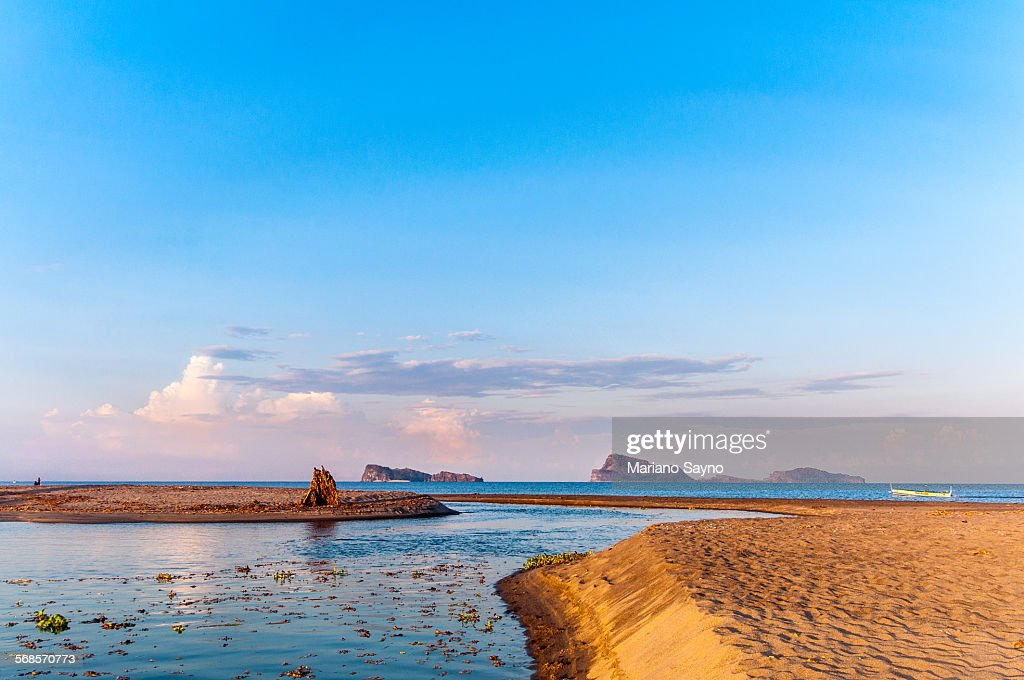 Scenic View Of Seascape Against Cloudy Sky : Stock Photo