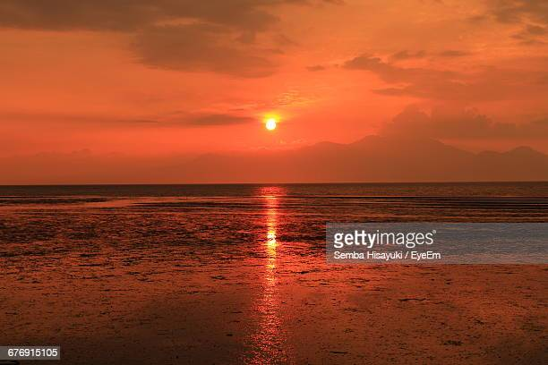 Scenic View Of Seascape Against Orange Sky