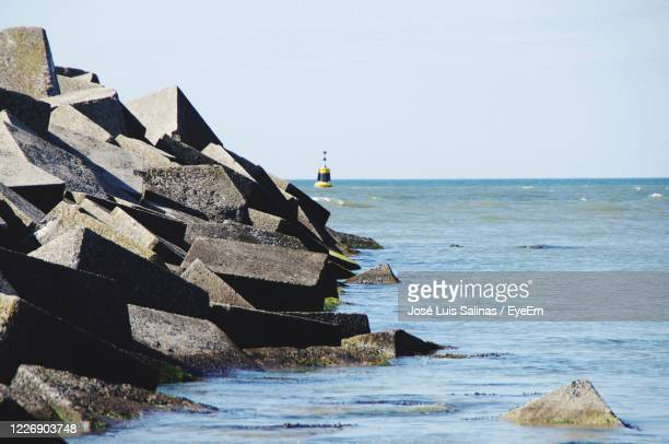 scenic view of seawall against clear sky - seawall stock pictures, royalty-free photos & images