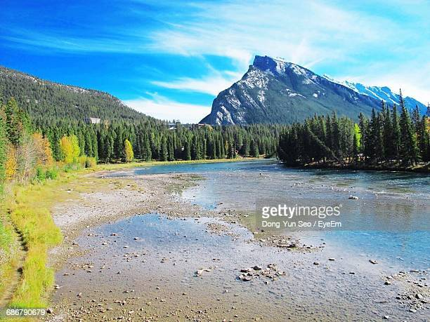 Scenic View Of Shallow River Against Mountains