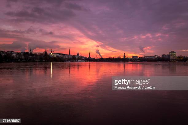 Scenic View Of Silhouette City Against Sky During Sunset