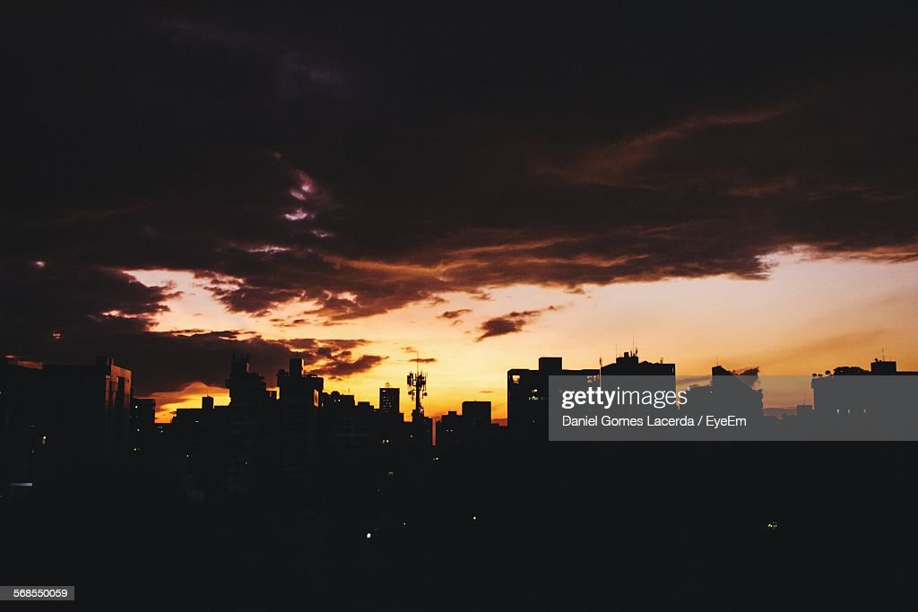 Scenic View Of Silhouette Cityscape Against Sky During Sunset : Stock Photo
