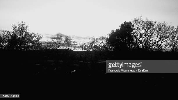 Scenic View Of Silhouette Field Against Clear Sky At Dusk