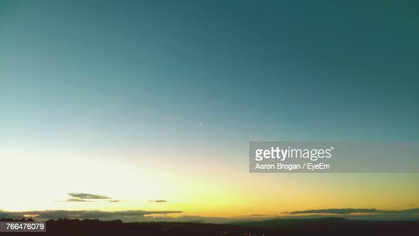Scenic View Of Silhouette Field Against Clear Sky At Night