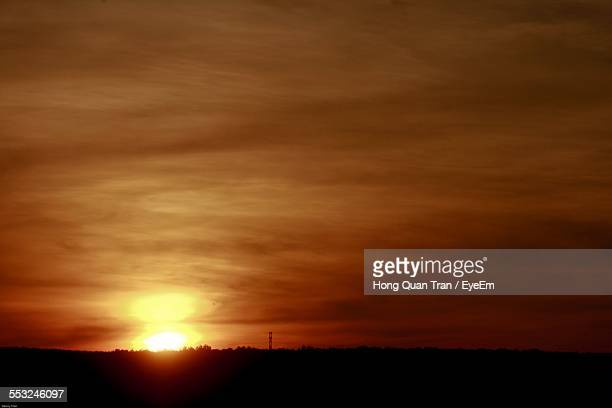 scenic view of silhouette field during sunset - hong quan stock pictures, royalty-free photos & images