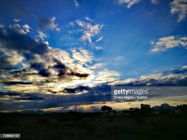 Scenic View Of Silhouette Landscape Against Blue Sky