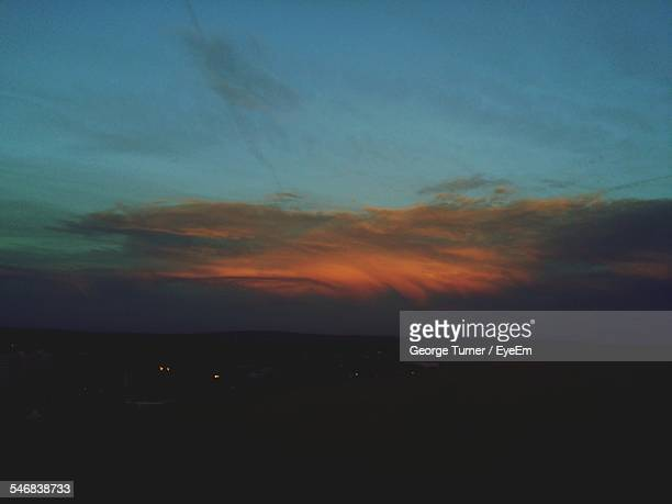 scenic view of silhouette landscape against cloudy sky at dusk - gillingham stock pictures, royalty-free photos & images