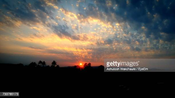 Scenic View Of Silhouette Landscape Against Orange Sky