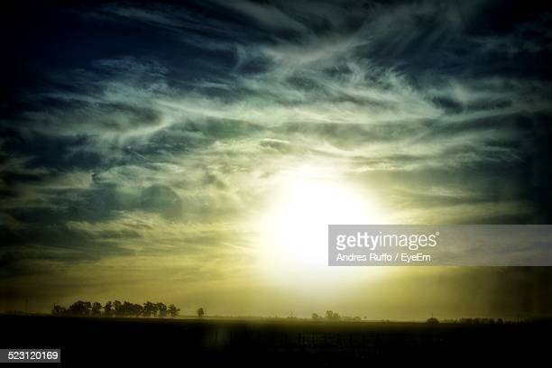 scenic view of silhouette landscape against sky at dusk - andres ruffo stock pictures, royalty-free photos & images