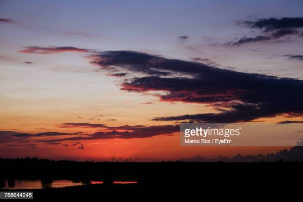 scenic view of silhouette landscape against sky at sunset - bos stock pictures, royalty-free photos & images