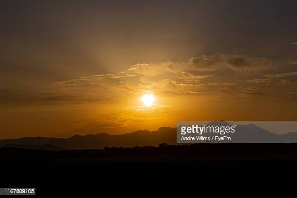 scenic view of silhouette landscape against sky during sunset - andre wilms eyeem stock-fotos und bilder