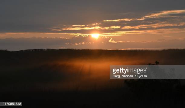 scenic view of silhouette landscape against sky during sunset - greg nadeau stock pictures, royalty-free photos & images