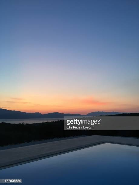 scenic view of silhouette landscape against sky during sunset - ellie price stock pictures, royalty-free photos & images