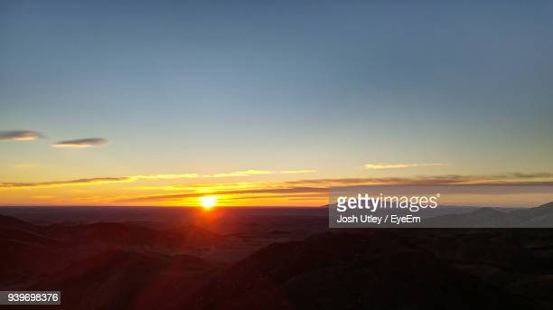 scenic view of silhouette landscape against sky during sunset - josh utley stock pictures, royalty-free photos & images