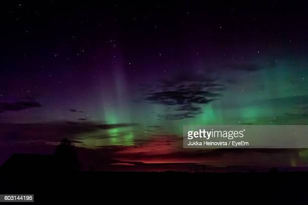 scenic view of silhouette landscape against star field at night - heinovirta stock pictures, royalty-free photos & images