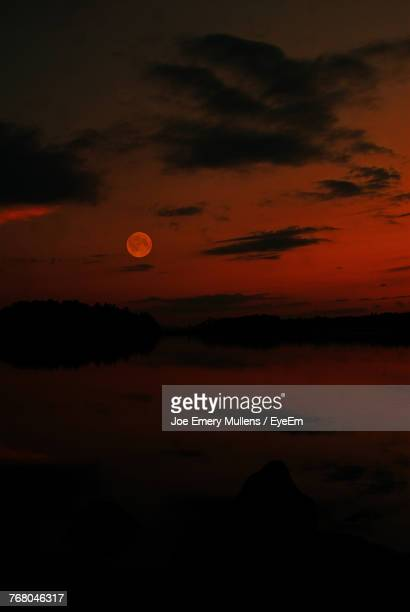 scenic view of silhouette moon against sky during sunset - emery stock photos and pictures