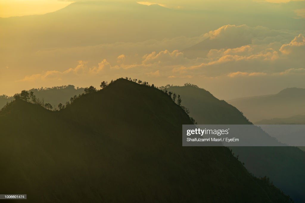Scenic View Of Silhouette Mountain Against Sky During Sunset : Stock Photo