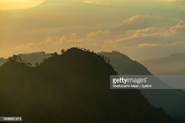 scenic view of silhouette mountain against sky during sunset - shaifulzamri stock pictures, royalty-free photos & images