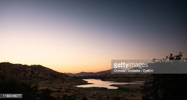 scenic view of silhouette mountains against clear sky during sunset - christian soldatke imagens e fotografias de stock