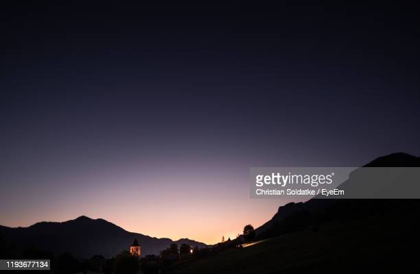 scenic view of silhouette mountains against clear sky during sunset - christian soldatke stock pictures, royalty-free photos & images