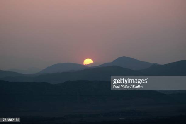 scenic view of silhouette mountains against clear sky during sunset - highlands ranch colorado stock pictures, royalty-free photos & images